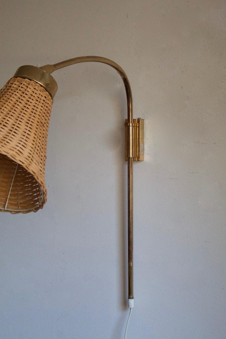Mid-Century Modern Josef Frank, Adjustable Wall Light, Brass, Rattan, Svenskt Tenn, Sweden, 1950s For Sale