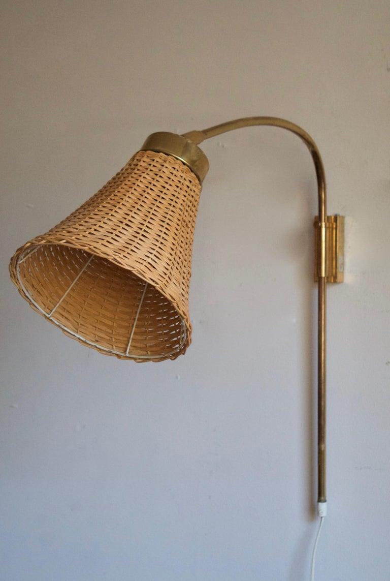 Swedish Josef Frank, Adjustable Wall Light, Brass, Rattan, Svenskt Tenn, Sweden, 1950s For Sale