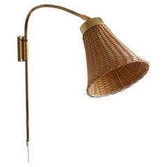 Josef Frank, Adjustable Wall Light, Brass, Rattan, Svenskt Tenn, Sweden, 1950s