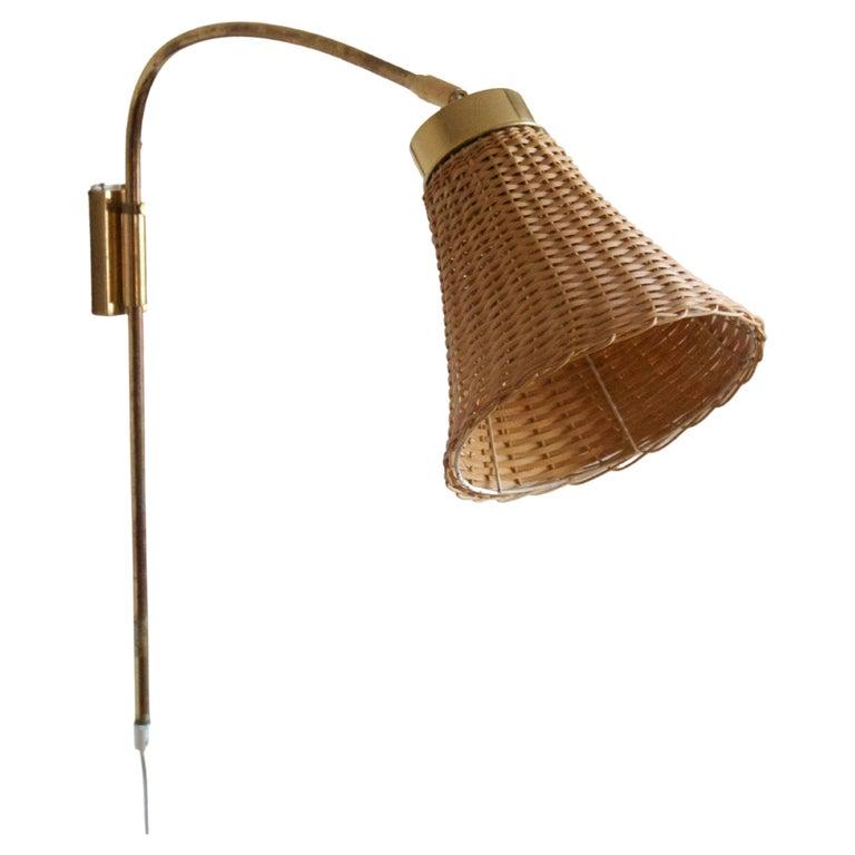 Josef Frank, Adjustable Wall Light, Brass, Rattan, Svenskt Tenn, Sweden, 1950s For Sale