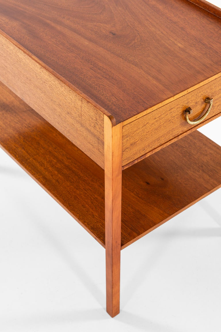 Bedside / side table designed by Josef Frank. Produced by Svenskt Tenn in Sweden.