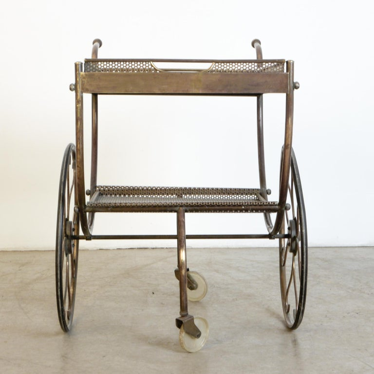 A great example of a classic design by Josef Svensk for Swedish furniture maker Svenskt Tenn from circa 1950. A beautiful decorative design with practical features, swivelling wheels, removable tray, and detailed construction. Great condition with a