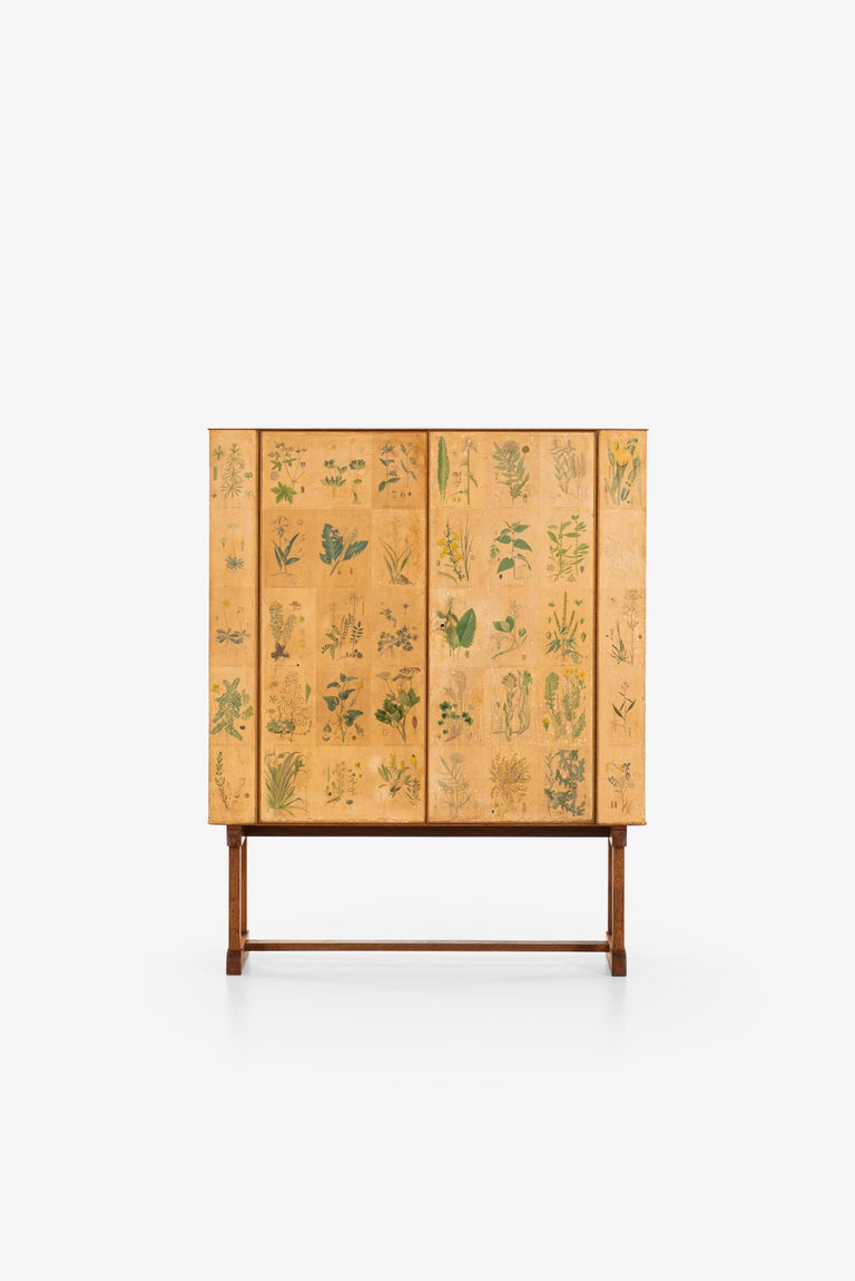 Very rare and early 1st edition of Flora / model 852 cabinet designed by Josef Frank. Produced by Svenskt Tenn in Sweden.