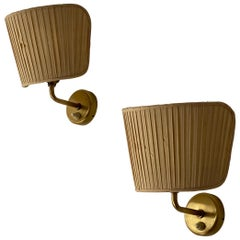 Josef Frank, Sconces / Wall lights, brass, fabric, Svenskt Tenn, Sweden, 1950s