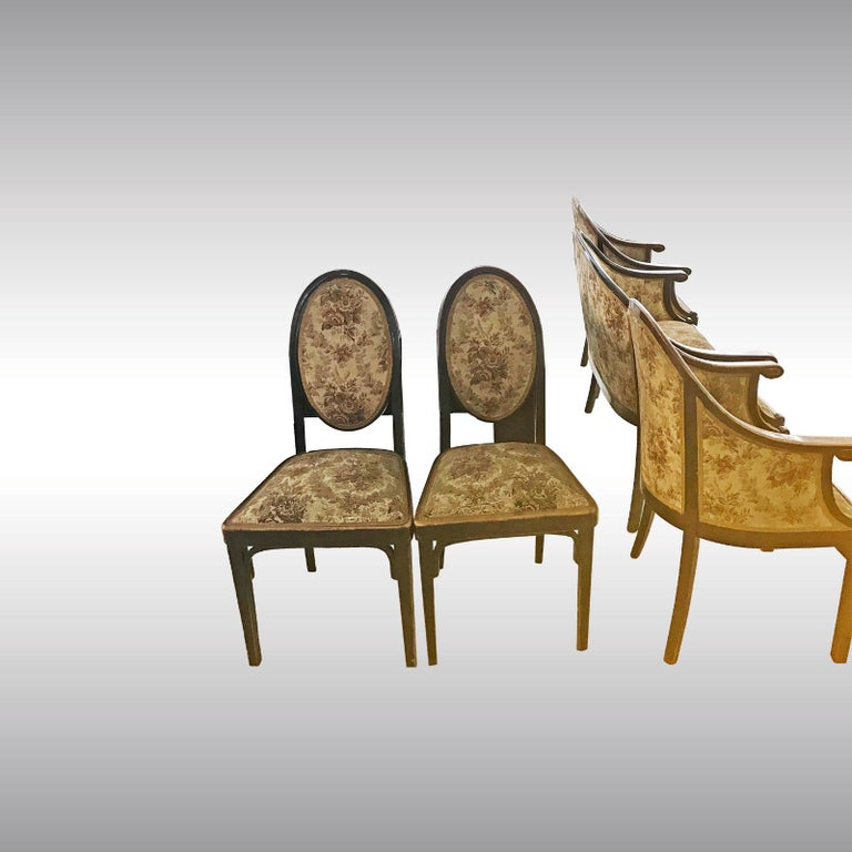 Ensemble consists of one settee, two armchairs and two chairs. The finish of the wood is in great condition, the upholstery is good, the fabric is to replace.