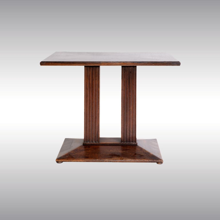 Beechwood, stained dark brown, legs with fluted decoration, signs of age, restored.