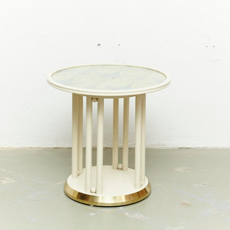 Table designed by Josef Hoffmann, circa 1905 for Cabaret Fledermaus in Viena. Manufactured by Wittmann (Austria), circa 1960. Lacquered wood and original upholstery.  With manufacturers label to the underside.  In original condition, with