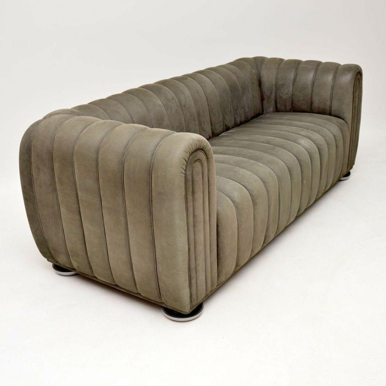 An absolutely stunning and iconic sofa, this was designed by Josef Hoffmann over 100 years ago, it's called the 1910 club sofa. This was made in Austria by Wittmann in the late 20th century, it is of the highest quality you could possibly imagine.