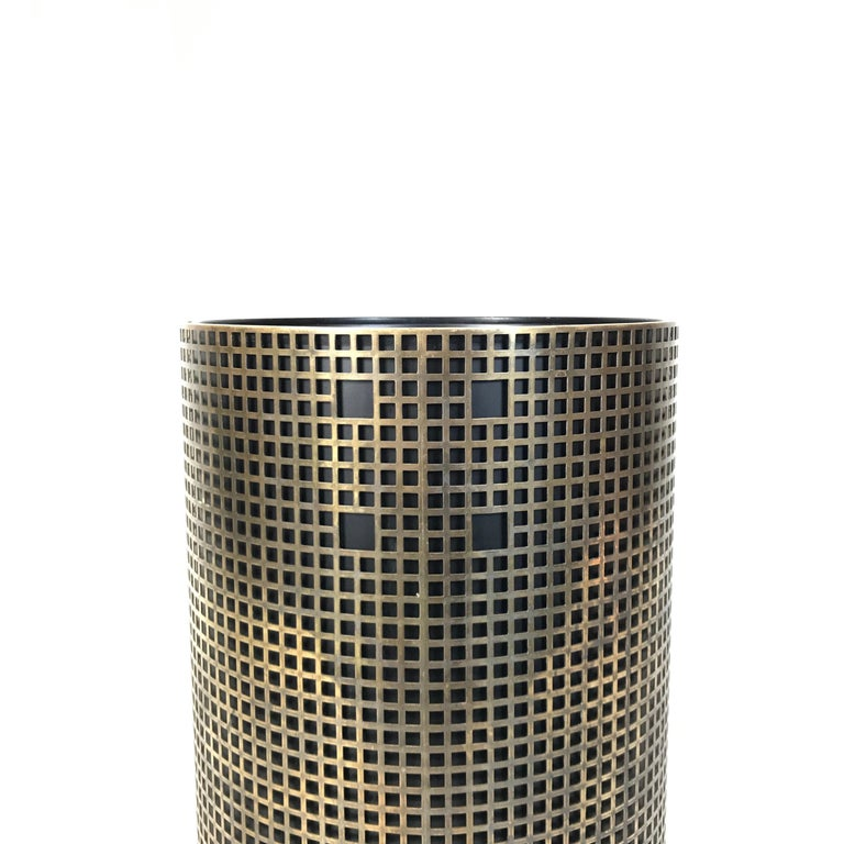 Simple and elegant umbrella stand in style of Josef Hoffmann. Made of perforated brass with lacquered metal basket. Very fine handwork without visible welds. The basket can also be used as a plant pot.  Measures: Height 40 cm / 15.7 in. Diameter