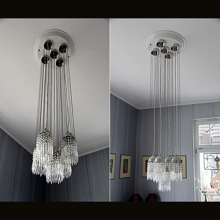 Chandelier for the entrance of the WW-showrooms in Neustiftgasse 32/34 in Vienna, design 1903. Four single pendants, mounted on a ceiling-plate. The single pendants are as well available #21626. Hammered or plain. The original started in an auction
