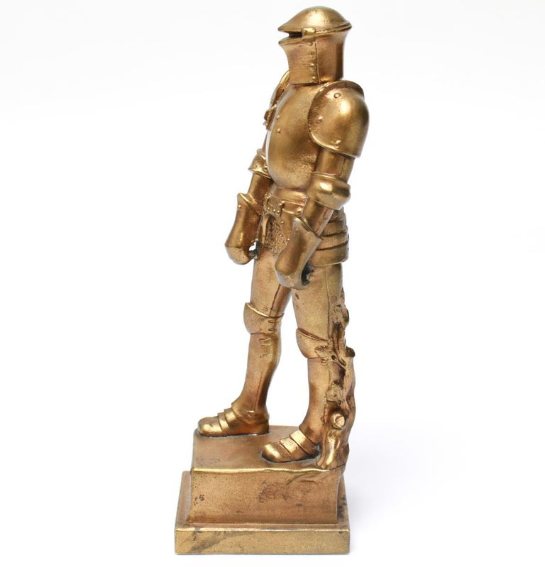 World War I Militaria gilt-bronzed cast iron figure of a knight in armor by Josef Muellner (Austrian 1879-1968). The knight stands atop a plinth inscribed