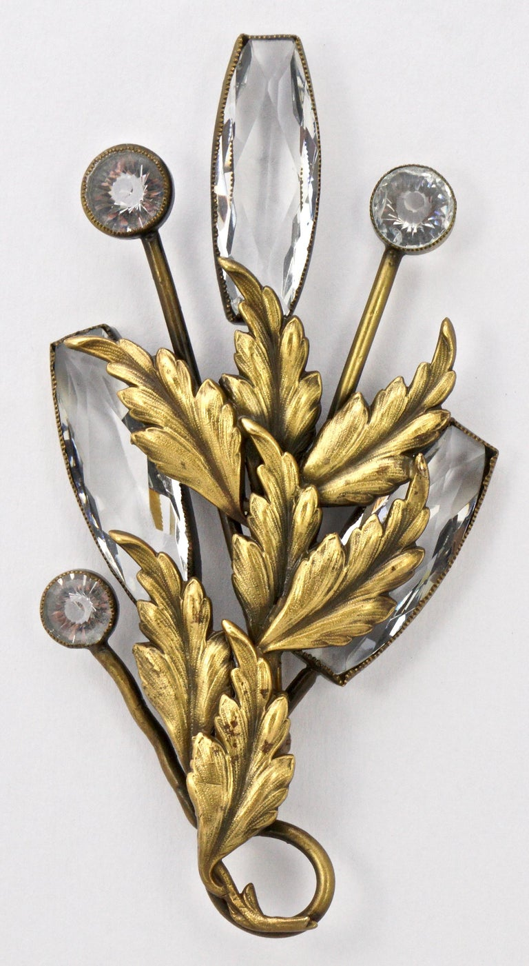 Joseff of Hollywood large brooch and clip-on earrings set. Featuring leaves with the Joseff Russian gold plated antique finish, and brilliant clear crystals. The brooch measures 12cm / 4.7 inches by 6.5cm / 2.5 inches, and the earrings are length