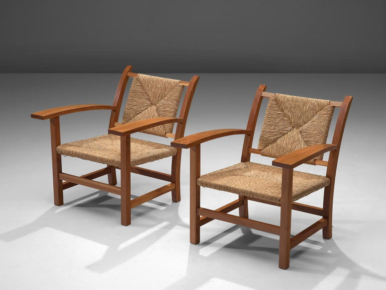 Josep Torres Clave, set of 2 armchairs, oak and cane, Spain, 1950s.   This set of armchairs by Josep Torres Clave have an oak frame and its seat and back upholstered in woven cane. The design is functionalistic, yet rustic. The armrests are