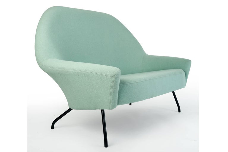 Joseph-André Motte (1925-2013)  Important, sculptural model 770 couch by Joseph-André Motte for Steiner. With a sinuous high back and dramatic winged armrests upholstered in linden green wool, supported by playfully slanted and curved black enameled
