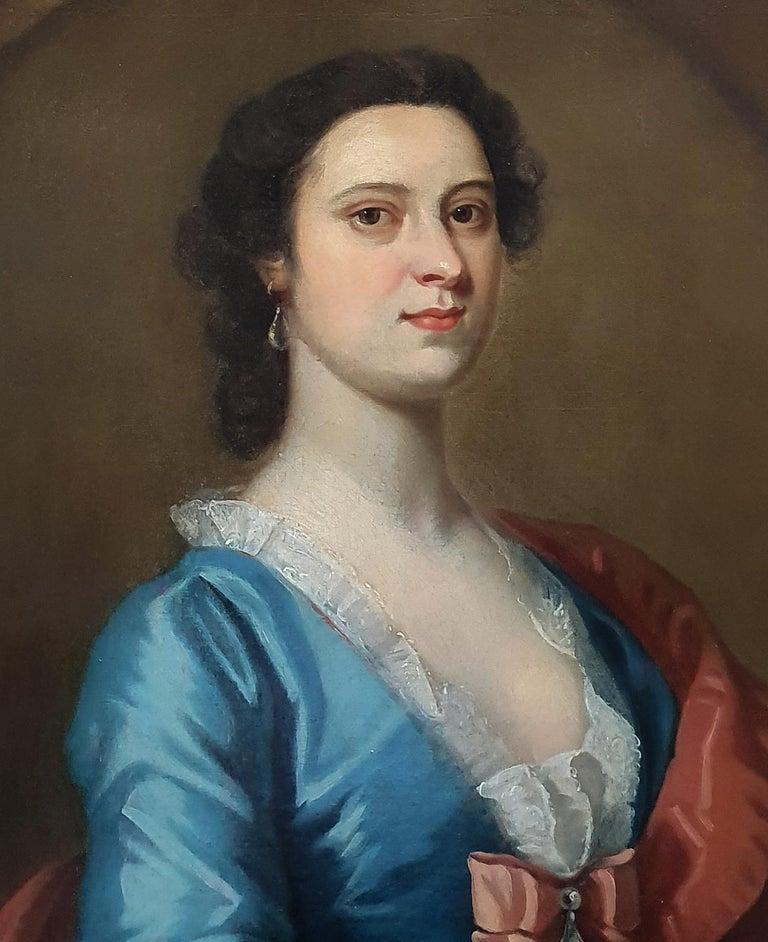 This picture was painted in England around 1740 and can be dated according to the hairstyle, the wide billowing sleeves with lace sleeve ruffles, the low neckline, and the large bow at the centre of the chest – this was extremely fashionable.  The