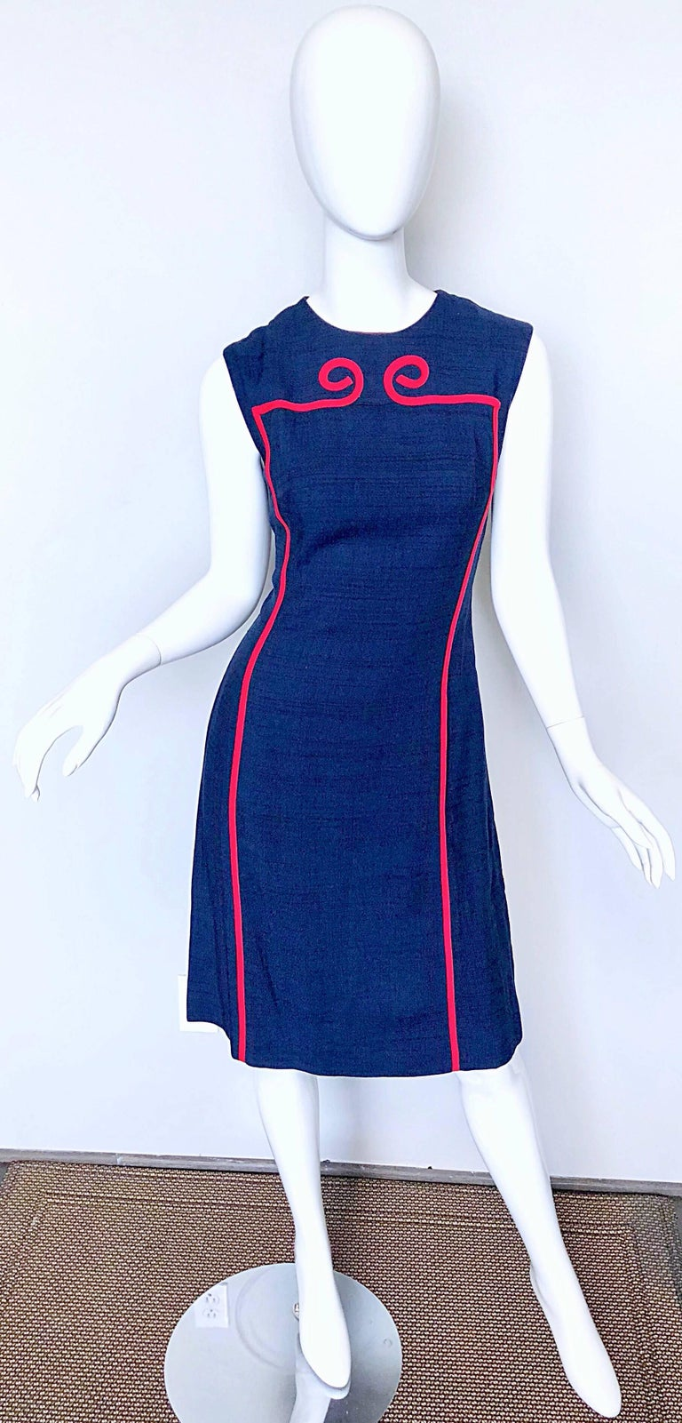 Amazingly chic 1960s JOSEPH MAGNIN navy blue and red linen and silk blend nautical shift dress! A dead ringer for Norman Norell, Pierre Cardin, or Louis Feraud.  Features a regal Roman like scroll red trim. Tailored bodice with a flattering shift