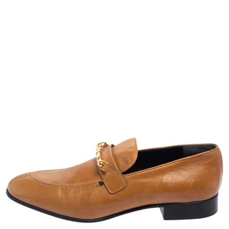 These stunning slip-on loafers by Joseph are stylish and comfortable. Crafted from tan leather, they are styled with a simple silhouette and feature round toes, leather lining, insoles, and soles. They are a must-have for those long days.  Includes: