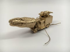 Cast metal sculpture of alligator head and truck body: 'Truckasuarus'