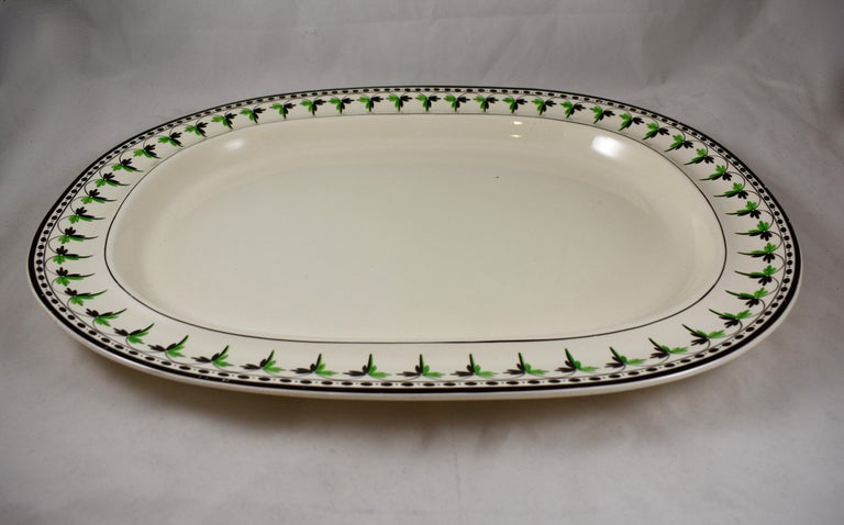 A rare find, a medium creamware platter from Josiah Spode, circa 1785. Spode is an English brand of pottery founded by Josiah Spode (1733-1797) based in Stoke-on-Trent, England.  The gorgeous creamware body has a hand painted fern and dotted