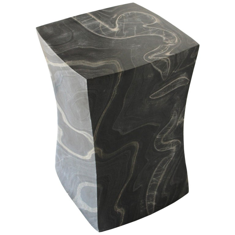 While inspecting the works in one of her workshop's, Stephanie Odegard encountered these beautiful blocks of black marble with exceptional grains in them and reserved them to not be carved as the Jali tables and instead to be made as the block
