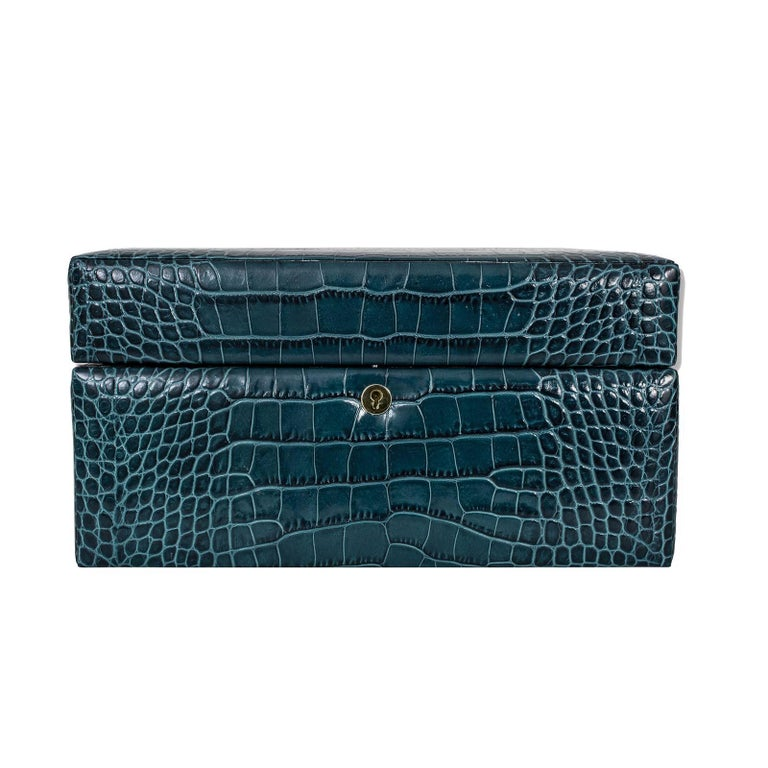 A refined gift to an elegant woman or a stunning addition to a personal collection, this jewelry box is a special piece of functional decor that stores precious items, while displaying elegance and sophistication. Its simple silhouette is