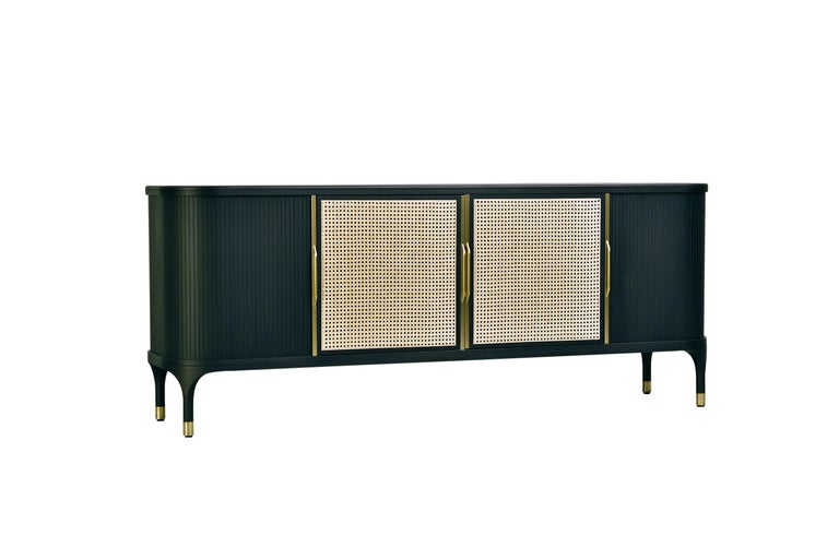 Contemporary style Joyce sideboard made of ashwood with glass top and brass tips. 
