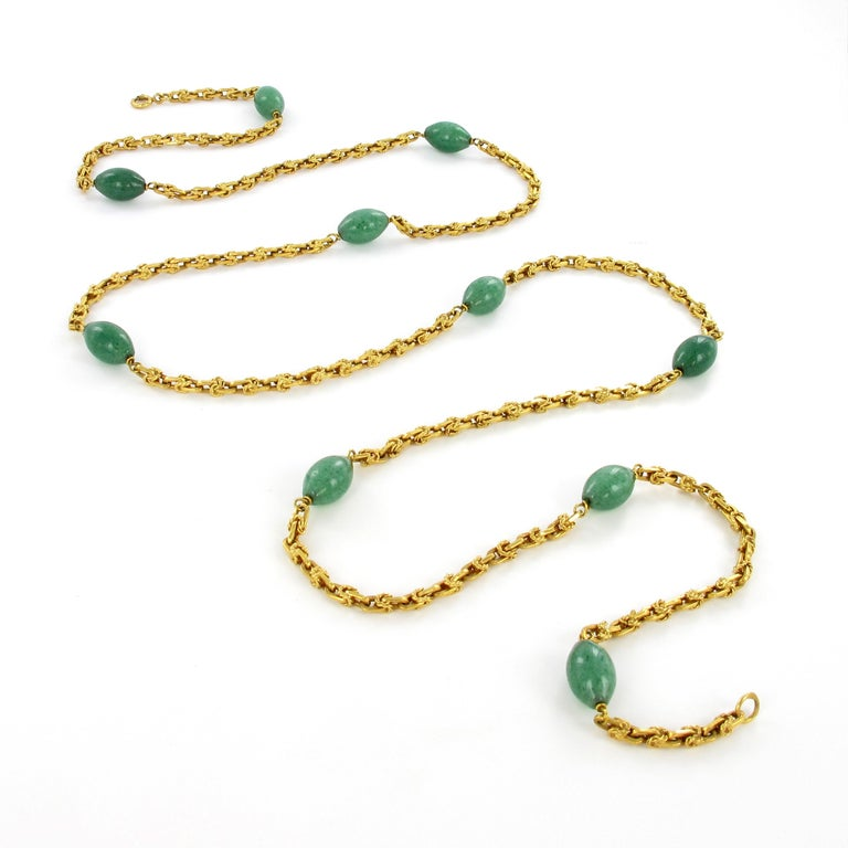 This summery necklace in 18 karat yellow gold adds an upbeat touch to any outfit. The fancifully decorated anchor chain is set with 10 aventurine quartz beads and has a spring ring clasp.  Maker's mark: Tännler of Switzerland Assay mark: 750 Length: