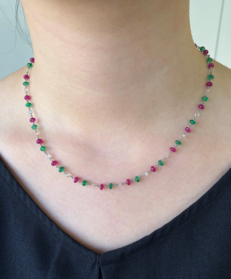 JR 18 karat White Gold Rose Cut Diamond Emerald Ruby Necklace  Why wear only one type of diamond when you can wear three kinds of exclusive jewels. This beautiful necklace will certainly add colour and brilliance to your look. Elegant 18.74 carats