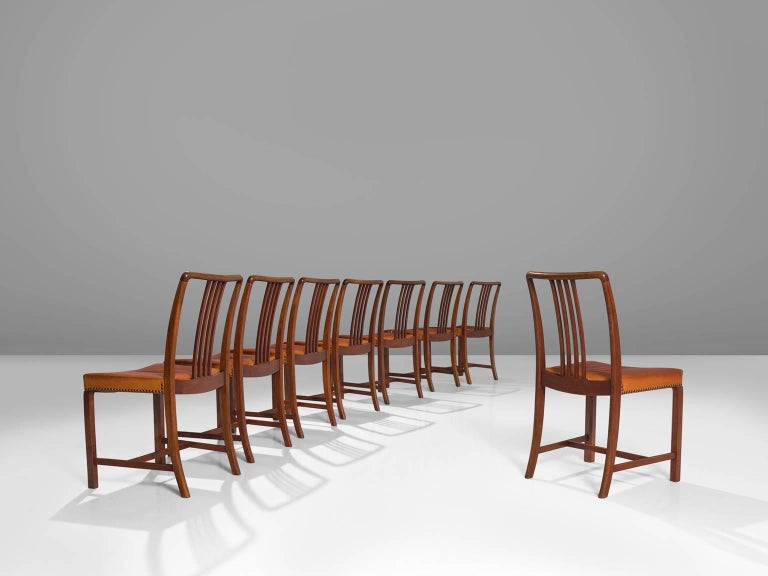 Jørgen Christensen designer and maker, set of eight dining chairs, leather, oak, Denmark, 1950s   This large set of modest Danish dining chairs is part of the midcentury design collection. The seats are upholstered with patinated natural leather