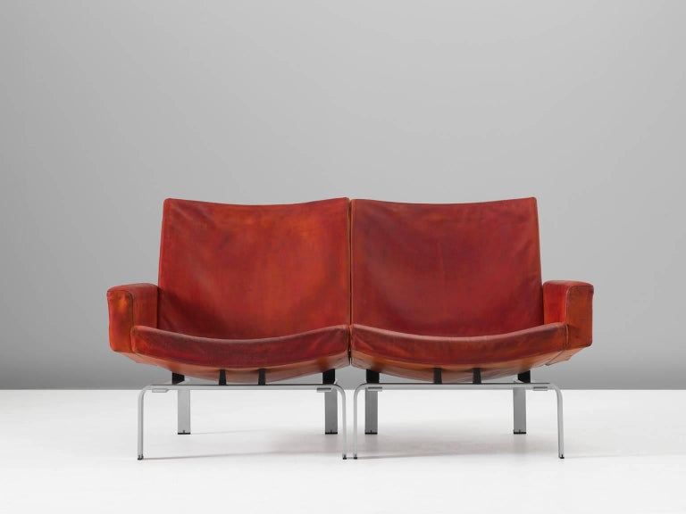 Jørgen Høj for Niels Vitsoøe, settee, leather and aluminum, Denmark, 1960s  Exclusive cognac leather sofa designed by Jørgen Høj, who worked in the same atelier together with Poul Kjaerholm. Sofa is supported by a well balanced aluminium frame