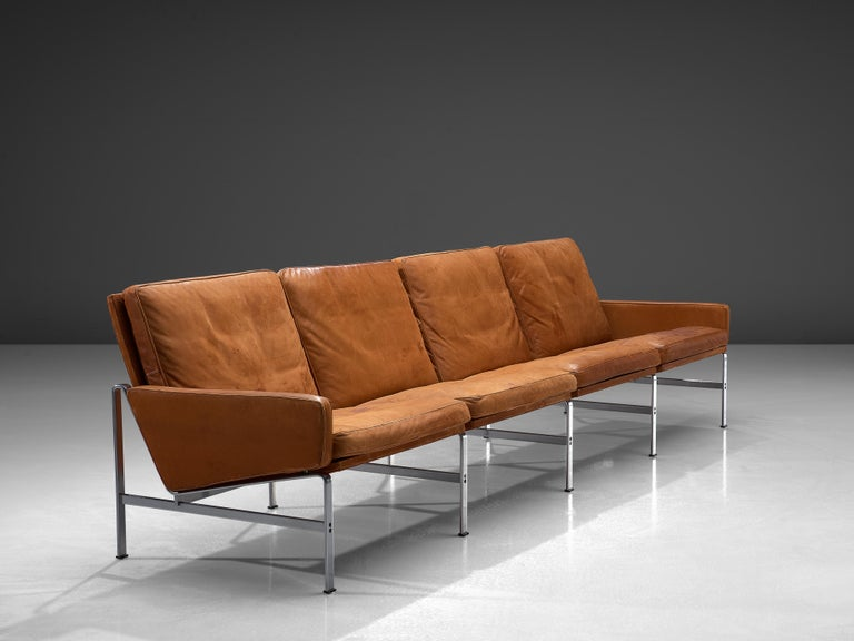 Jørgen Kastholm & Preben Fabricius for Kill International, four-seat sofa, leather, steel, Denmark, 1960s.  Large sofa in patinated cognac leather by Fabricius and Kastholm. The base of this sofa gives a characteristic and open character. Moreover,