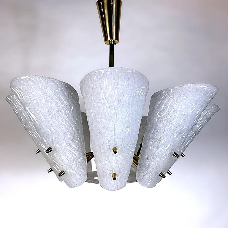 Beautiful Mid-Century Modern frosted milk glass chandelier manufactured by J.T. Kalmar, with the characteristic blown ice glass plates. This chandelier is a striking appearance in every room. Due to the sublime combination of glass and brass - this