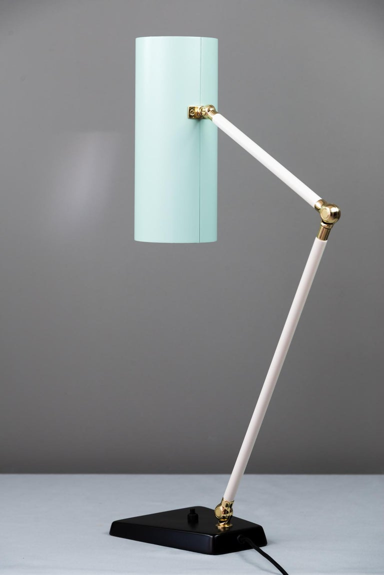 Swiveling J.T. Kalmar table lamp, Vienna, circa 1960s Restored Metal and aluminium painted Brass polished and stove enameled Completely stretched out is the lamp 84 cm.