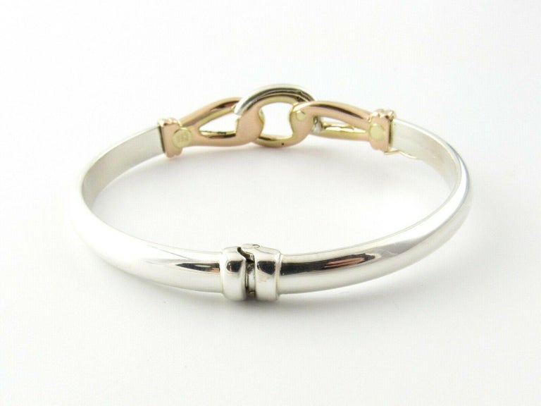 JTL Isreal 14K Rose Gold and Sterling Silver Bangle Diamond Hinged Bracelet  This beautiful bangle bracelet is approx. 7.25