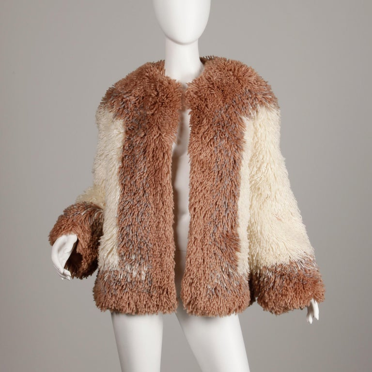Incredible heavy weight shaggy wool jacket in two tone brown and beige by Judith Ann. A great fur alternative with the same winter warmth! Fully lined with no closure (hangs open). Hidden side pockets. Fits like a modern size large-extra large. The