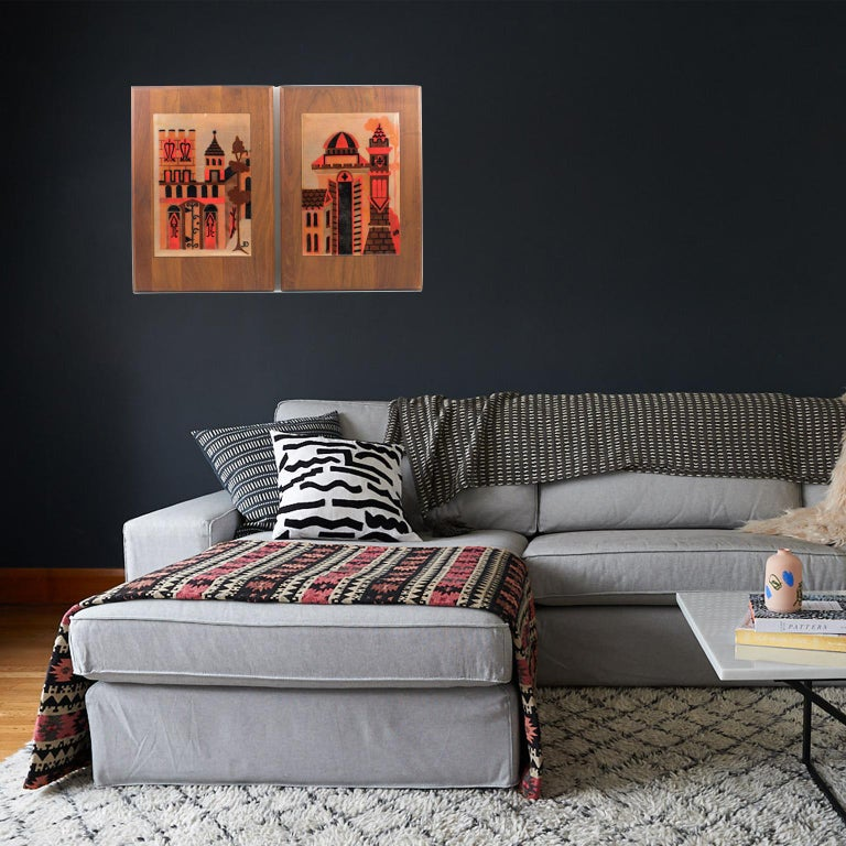 Superb Mid-Century modernist enamel on copper artwork by Judith Daner, a pair. One tile plaque mounted on the original walnut wood frame. Abstract and stylized design featuring cityscape and various types of buildings. Judith Daner used the