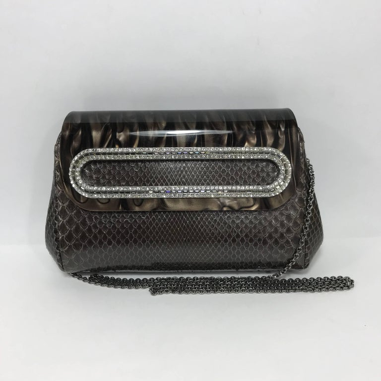 Condition - Very Good, one rhinestone missing.  SKU - 2 - SA  Original Retail Price - $3,295 (Approx.)  Date/ Serial Code - N/A  Dimensions - 9 x 3 x 5.5 inches  Strap Drop - 24 inches (Tuck away metal chain strap)  Materials - Python, Resin and