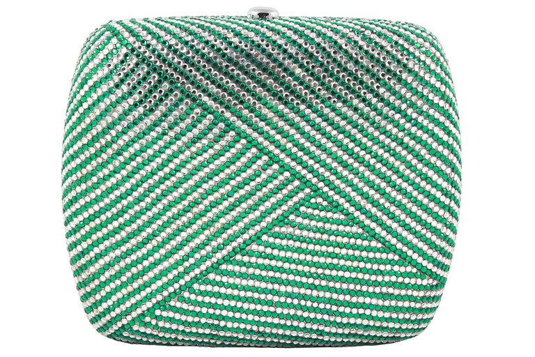 Judith Leiber clutch  Clear and green rhinestones in a stripe pattern  Silver snap closure  Silver chain strap that can be stored inside  Soft silver leather lining Comes with silver coin purse, mirror, comb and blue dust-bag