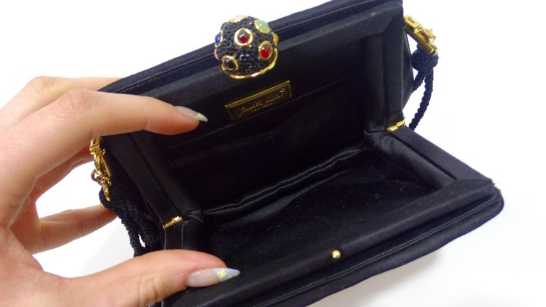 Elevate your look with this amazing Leiber! Circa 1970s, this bag features a gorgeous patchwork motif with colorful rhinestone embellishing, a removable black rope shoulder strap, and a cabochon top closure. Interior is lined with black satin and