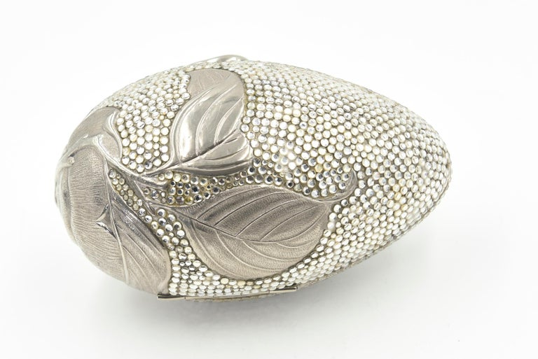Judith Leiber Floral & Insect Oval Silver Crystal Minaudière Evening Bag In Good Condition For Sale In Miami Beach, FL