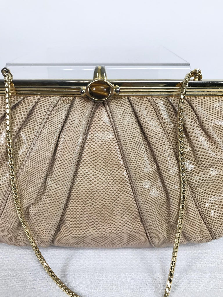 Judith Leiber gold frame, tiger eye stone clasp pale taupe lizard clutch or shoulder bag from the 1980s. Hidden gold flat chain strap, the bag is lined in gold faille. Interior zipper side pocket. With protector bag. In very good pre owned