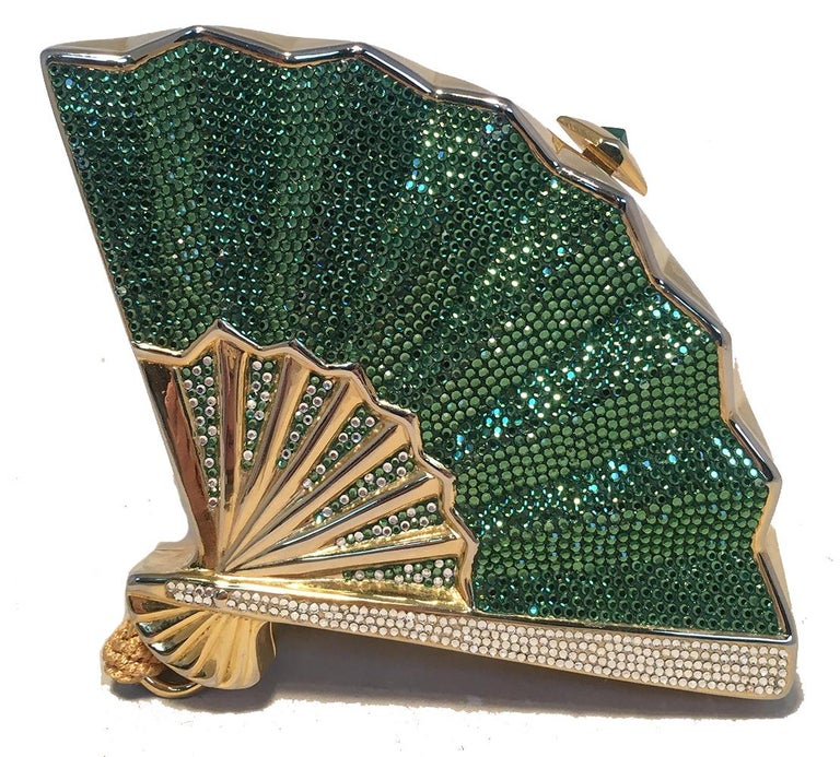 Judith Leiber Swarovski Crystal Fan Minaudiere Evening Bag Clutch Wristlet in excellent condition. Gold metal body in a unique fan shape with green, clear, and gold swarovski crystals around the front and back sides. Golden woven nylon tassel wrist