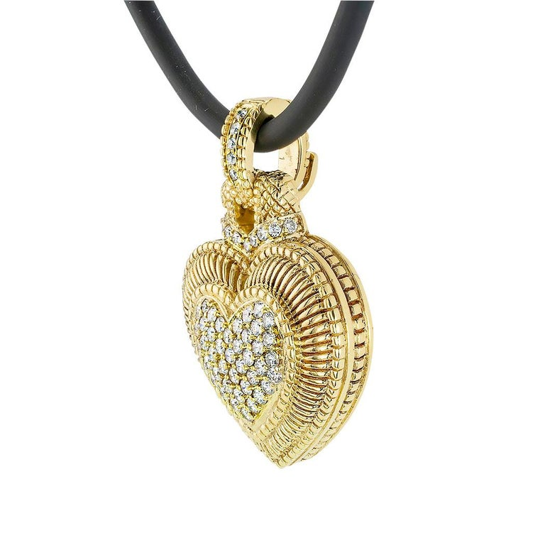 Judith Ripka diamond and yellow gold heart-shaped enhancer pendant.  Love it because it caught your eye and we are here to connect you with beautiful and affordable jewelry.  Make yourself happy!  Simple and concise information you want to know is