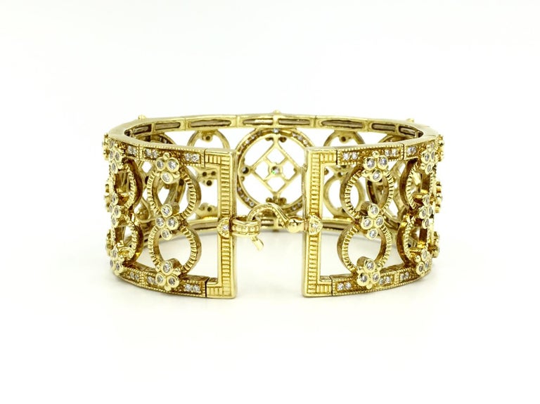 Designed in the classical and elegant style of Judith Ripka, this 18 karat yellow gold intricate diamond cuff bracelet is from the exquisite Garland collection. This Victorian Era inspired bracelet has a total diamond weight of 3.68 carats. Diamonds