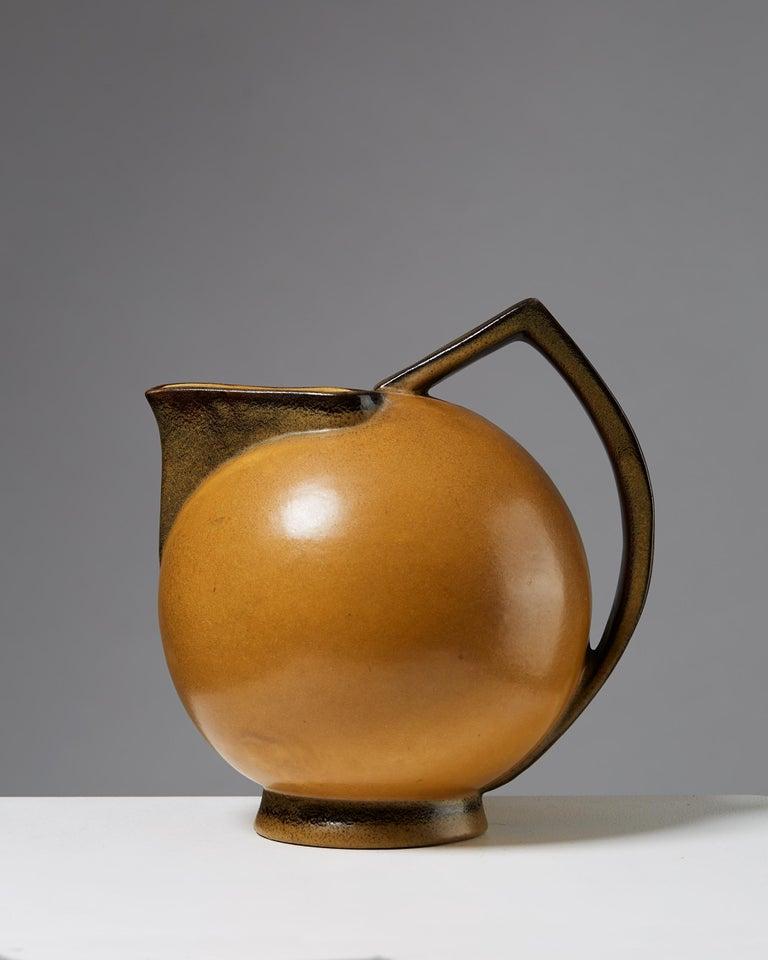 Stoneware.   Measures: Height 24 cm/ 9 3/8