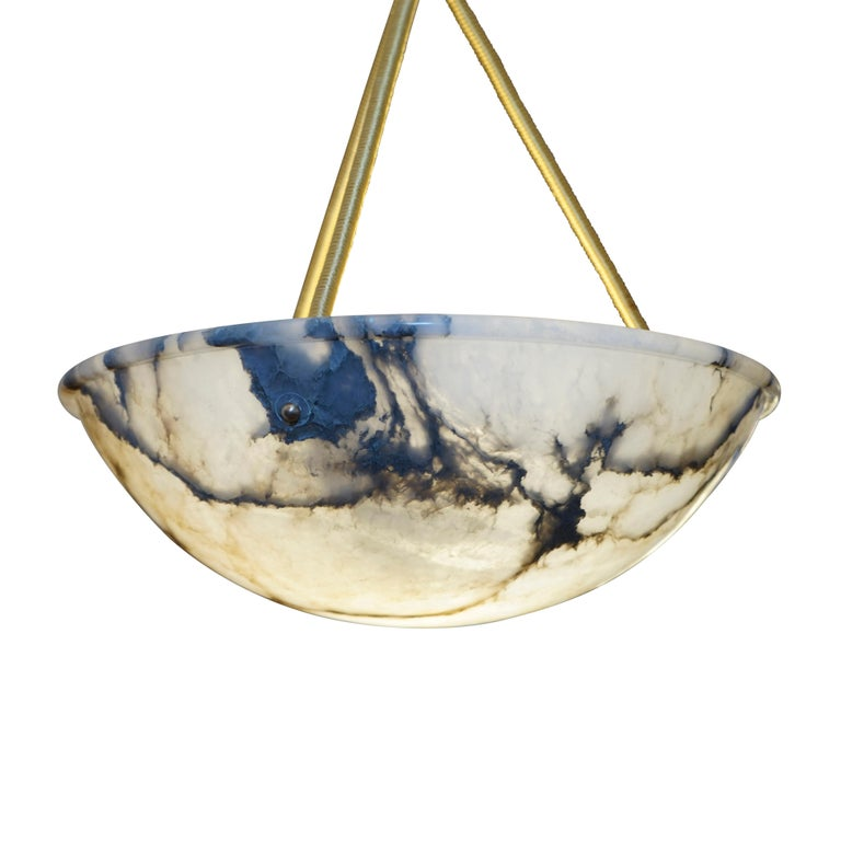 A pure example of a Classic Swedish design with a defined, singular upper rim and brilliant mineral veined alabaster streaked with crystal. This type of lighting was sleek and typified the new century's fascination with the recently perfected use of