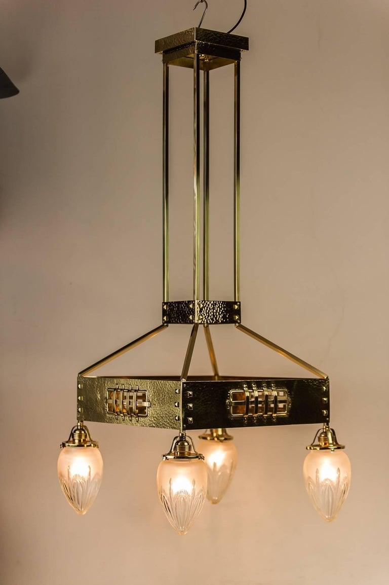 Jugendstil hammered chandelier, circa 1910s Original glasses Polished and stove enameled.