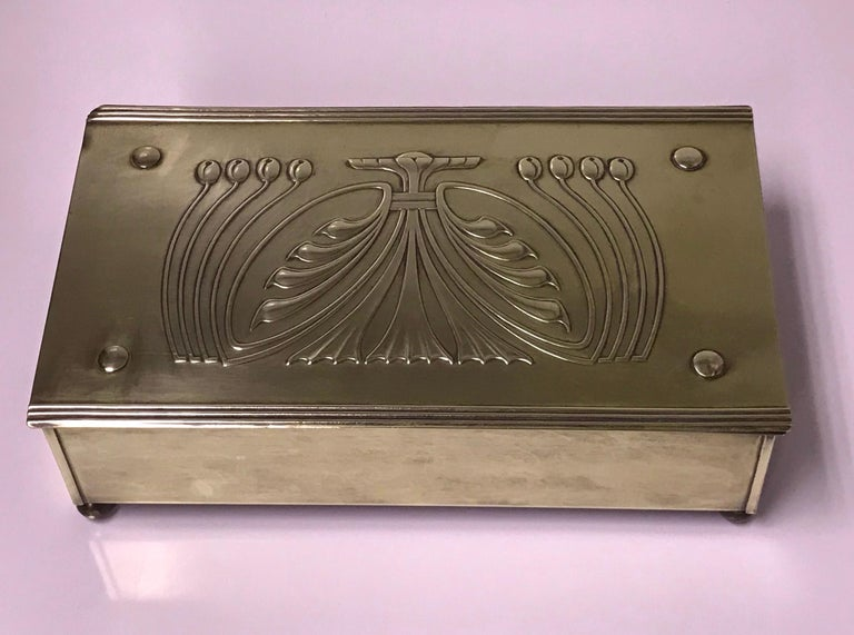 Jugendstil Nouveau secessionist brass box, Carl Deffner Germany, circa 1910. The large rectangular box on four bun supports, stylized foliate hinged cover, plain sides. Cedar lined interior. CDE mark on underside. Measures: 9.125 x 5.25 x 2.60