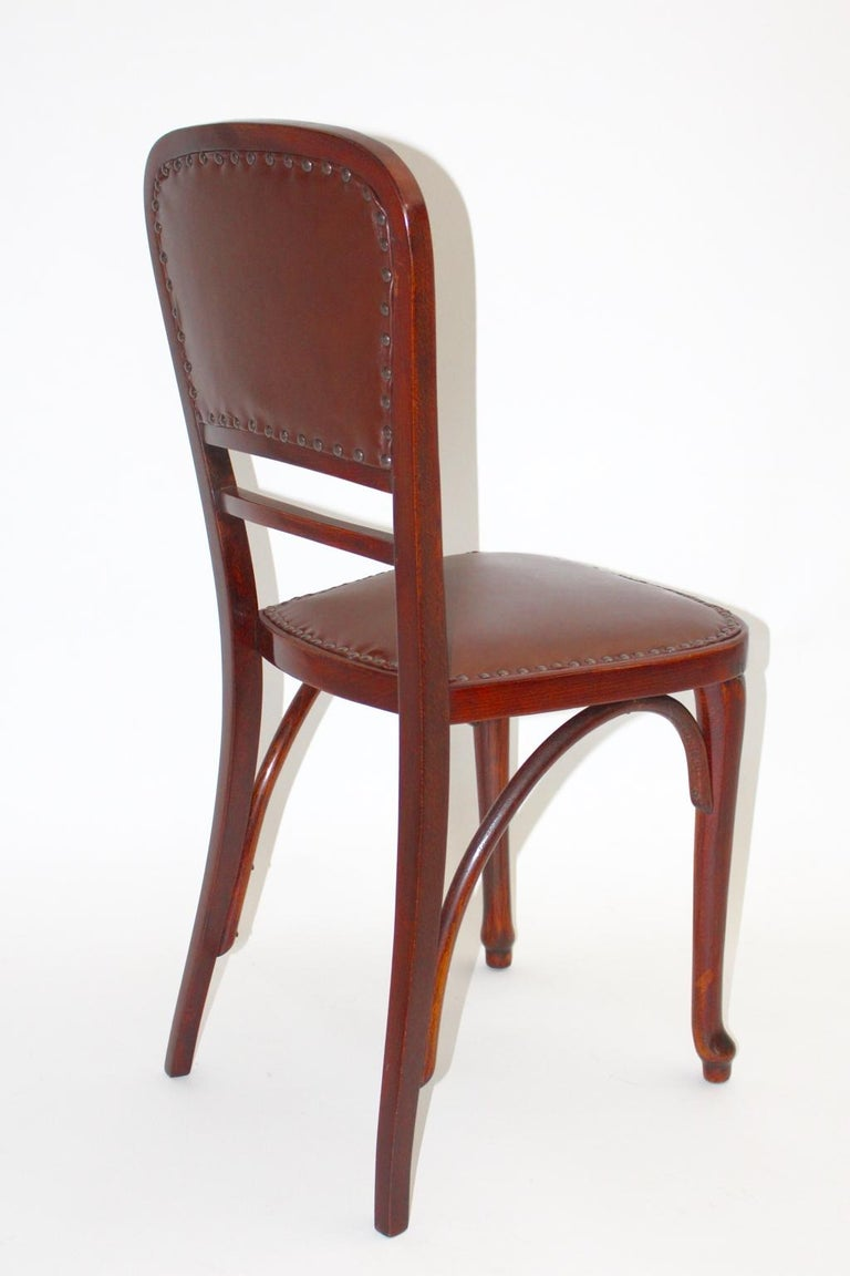 Jugendstil vintage beech and leather Viennese chair by Thonet got the Kat. Nr. 491 designed and manufactured circa 1904. The chair frame was made of beechwood and is cleaned and hand-polished furthermore the seat and the back is covered with cognac