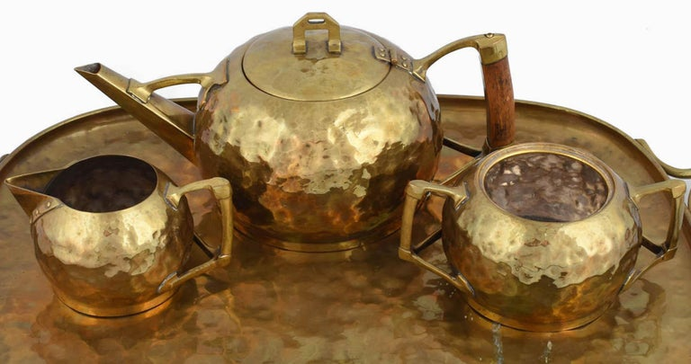 Jugendstil Centrepiece / Teaset with tray is an original decorative object realized in the 1910s.   Original brass set.   The centrepiece includes different pieces: a sugar bowl, a mikl bowl, a teapot and a tray.   Fair conditions; missing